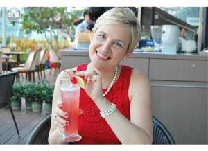 Cheers! Wearing red, the national color of Singapore.