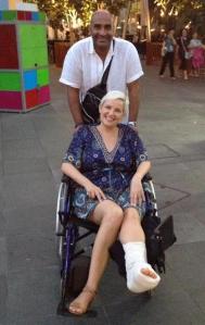 Husband pushing wheelchair